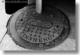 asia, black and white, covers, horizontal, lhasa, manholes, streets, tibet, xinsheng, photograph