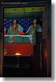 asia, asian, buddhas, buddhist symbols, candles, glow, lights, style, tan druk temple, tibet, vertical, photograph