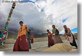 asia, asian, emotions, flags, horizontal, people, poles, prayers, smiles, tibet, walking, yumbulagang, photograph
