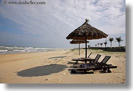 asia, beaches, conical, danang, horizontal, straws, umbrellas, vietnam, photograph