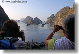 asia, boats, cameras, ha long bay, harbor, horizontal, mountains, nature, people, photographing, tourists, vietnam, womens, photograph
