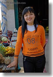 asia, asian, girls, ha long bay, oranges, people, sweater, vertical, vietnam, photograph