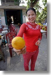 asia, asian, ha long bay, lemon, people, vertical, vietnam, womens, photograph