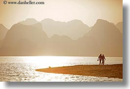 asia, beaches, colors, ha long bay, horizontal, mountains, nature, sky, sun, sunsets, vietnam, walkers, yellow, photograph