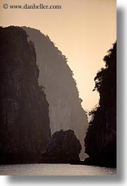 asia, ha long bay, hazy, mountains, ocean, sunsets, vertical, vietnam, photograph
