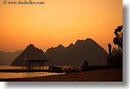 asia, colors, ha long bay, horizontal, mountains, nature, photographers, silhouettes, sky, sun, sunsets, vietnam, yellow, photograph