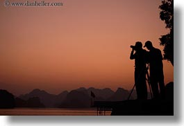 asia, colors, ha long bay, horizontal, mountains, nature, oranges, photographers, silhouettes, sky, sun, sunsets, vietnam, photograph