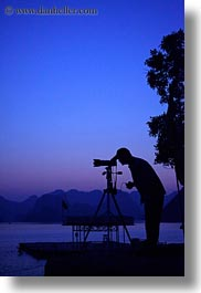 asia, dusk, ha long bay, photographers, silhouettes, sunsets, vertical, vietnam, photograph