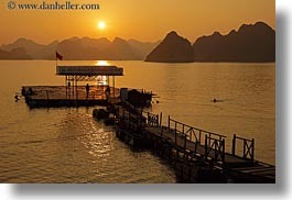 asia, colors, dock, ha long bay, horizontal, mountains, nature, sky, sun, sunsets, vietnam, yellow, photograph