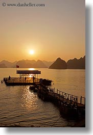 asia, colors, dock, ha long bay, mountains, nature, sky, sun, sunsets, vertical, vietnam, yellow, photograph