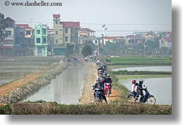 asia, bikes, crowds, driving, hanoi, horizontal, motorcycles, vietnam, water, photograph