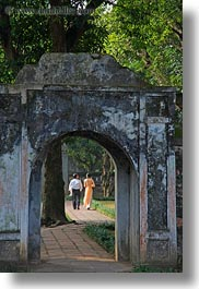 archways, asia, confucian temple literature, couples, hanoi, people, vertical, vietnam, walking, photograph