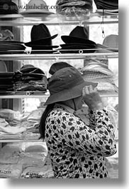 asia, black and white, hanoi, hats, shops, vertical, vietnam, womens, photograph