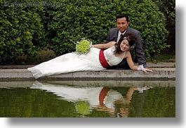 asia, brides, brooms, couples, flowers, hanoi, horizontal, people, reclining, vietnam, water, photograph