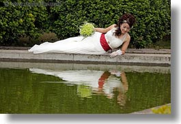 asia, brides, couples, flowers, hanoi, horizontal, people, reclining, vietnam, water, photograph