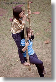 asia, couples, hanoi, people, swings, two, vertical, vietnam, womens, photograph