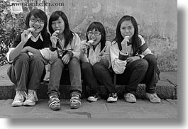 asia, black and white, girs, hanoi, horizontal, ice cream, people, teenage, vietnam, womens, photograph