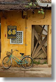 asia, bicycles, bikes, hoi an, vertical, vietnam, walls, yellow, photograph