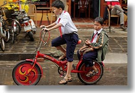 Bikes For Toddlers Boys boy n toddler on red bike jpg
