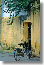 asia, bicycles, bikes, hoi an, old, vertical, vietnam, walls, yellow, photograph