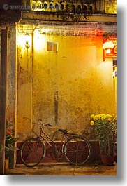 asia, bicycles, bikes, hoi an, nite, red, vertical, vietnam, walls, yellow, photograph
