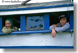 asia, boats, hoi an, horizontal, looking, men, out, vietnam, windows, photograph
