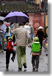 asia, boys, childrens, hoi an, men, old, people, umbrellas, vertical, vietnam, walking, photograph
