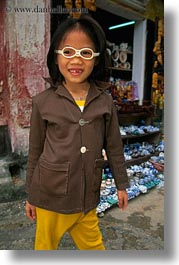 asia, childrens, girls, glasses, hoi an, humor, laughing, people, vertical, vietnam, photograph