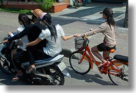 asia, bikes, girls, hands, holding, horizontal, hue, motorcycles, vietnam, photograph