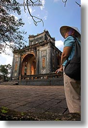 asia, clothes, conical, hats, hue, khai dinh, pavilion, stele, tourists, tu duc tomb, vertical, vietnam, womens, photograph