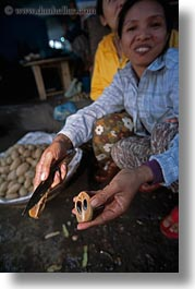 asia, hue, market, nuts, offerings, vertical, vietnam, womens, photograph