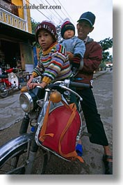 asia, asian, childrens, fathers, hue, motorcycles, people, vertical, vietnam, photograph
