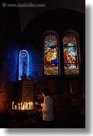 asia, asian, candles, catholic, glow, lights, materials, men, neon, people, saigon, stained glass, vertical, vietnam, photograph