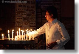 asia, asian, candles, catholic, glow, horizontal, lights, men, people, saigon, vietnam, photograph