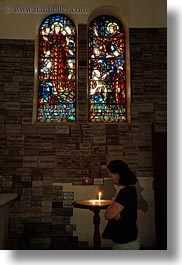 asia, asian, candles, catholic, glow, lights, materials, people, saigon, stained glass, vertical, vietnam, womens, photograph