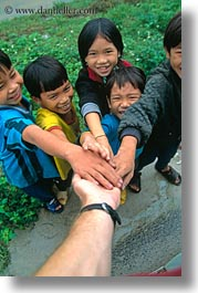 asia, asian, childrens, downview, emotions, groups, people, perspective, smiles, vertical, vietnam, villages, photograph