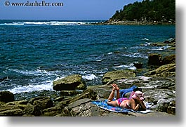 australia, horizontal, manly beach, reading, rocks, sydney, womens, photograph