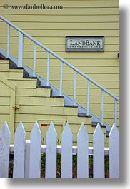 bank, buildings, california, colors, fences, land, mendocino, signs, structures, vertical, west coast, western usa, yellow, photograph