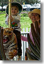 amusement park ride, boys, california, childrens, happy, hats, jacks, merry go round, oakland zoo, toddlers, vertical, west coast, western usa, photograph