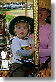 amusement park ride, boys, california, childrens, hats, jacks, merry go round, oakland zoo, toddlers, vertical, west coast, western usa, photograph