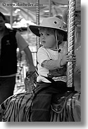 amusement park ride, black and white, boys, california, childrens, hats, jacks, merry go round, oakland zoo, toddlers, vertical, west coast, western usa, photograph