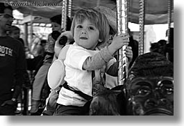 amusement park ride, black and white, boys, california, childrens, horizontal, jacks, merry go round, oakland zoo, toddlers, west coast, western usa, photograph