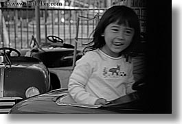 amusement park ride, asian, black and white, california, cars, childrens, driving, girls, happy, horizontal, oakland zoo, people, west coast, western usa, photograph
