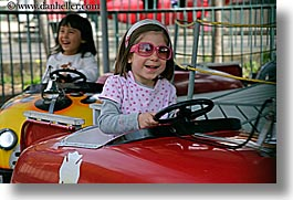 amusement park ride, california, cars, childrens, driving, girls, glasses, happy, horizontal, oakland zoo, people, west coast, western usa, photograph