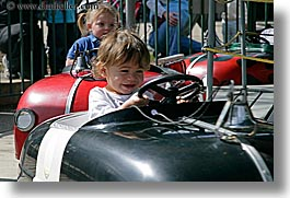 amusement park ride, california, cars, childrens, driving, girls, happy, horizontal, oakland zoo, people, west coast, western usa, photograph