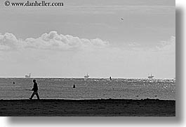 beaches, black and white, california, clouds, horizontal, men, nature, oil rig, oils, rigs, santa barbara, sky, structures, walking, west coast, western usa, photograph