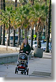 babies, boys, california, childrens, jills, mothers, nature, palm trees, people, plants, pushing, santa barbara, stroller, trees, vertical, west coast, western usa, womens, photograph
