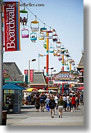 amusement park, banners, boardwalk, california, crowds, dipper, giants, people, santa cruz, signs, vertical, west coast, western usa, photograph