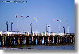 california, coastline, flags, horizontal, lamp posts, nature, ocean, piers, santa cruz, structures, water, west coast, western usa, photograph