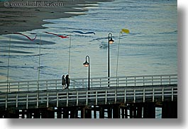 activities, california, coastline, couples, flags, horizontal, lamp posts, nature, ocean, people, piers, santa cruz, structures, walk, water, west coast, western usa, photograph